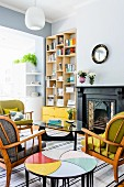 Retro seating area with original side tables; modern bookcase and bright yellow drawers in niche