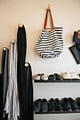Shoe rack & wooden pegs as coat hooks for bags & scarves