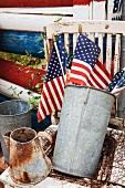 American flags in metal bucket