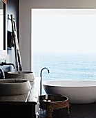 Designer bathroom with sea view through panoramic window