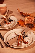 Place setting with linen napkin and autumnal decorations