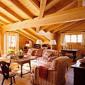 Elegant chalet living room with heavy roof-beam structure and antique furniture