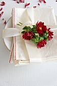 Linen napkin with asters and a ribbon