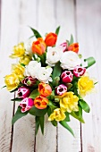 A springtime bouquet with tulips and ranunculus