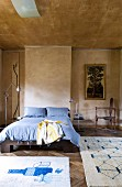 Simple double bed and unusual collector's items combined with marbled walls and ceiling