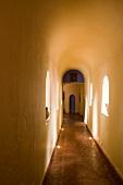 Long, narrow hallway with a barrel ceiling in an Ecuadorian manor house