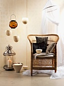 African touch with rattan chair, pillows, hanging bowls and decorative candles