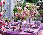 Festive table with pink magnolias and willow tree branches