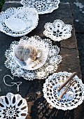 Dishes made from lace doilies on stone step