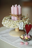 Bundle of candles in a willow wreath and Easter eggs