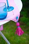 Tablecloth with homemade tassel on a patio table