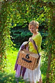 Lady with a picnic basket in the garden