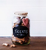 Dog biscuits in screw-top jar with chalk label