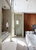 Spacious bathroom with twin washbasins, bathtub & separate, glazed shower area