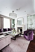Furniture with grey and violet upholstery in elegant living room with square, mirror-topped coffee table in centre