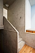 Concrete and pale wood stairwell