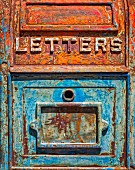 Old letter box with peeling paint (USA)