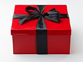 Red Gift Box with a Black Ribbon; Box of Chocolates