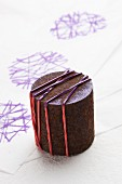 Improvised stamp block made from old iron cylinder and rubber bands