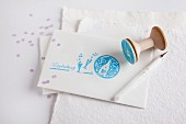 White envelope decorated with various rubber stamp prints