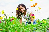 Young woman gardening in allotment
