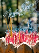 Lit joss sticks in front of temple (Siem Reap, Cambodia)