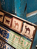 Painted tiles on Moroccan market stall