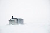 Cabin in snowy landscape (Spitsbergen, Norway)