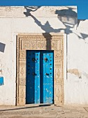 House entrance with blue door & wall tiles (El Djem, Tunisia)
