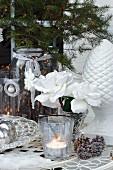 Wintery arrangement on outdoor terrace table