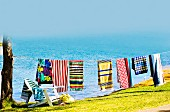 Colourful beach towels on washing line at seaside