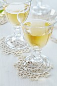 Crocheted doilies used as coasters for wine glasses