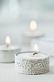 Tealights decorated with lace ribbon