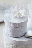 Gift boxes decorated with lace trim and lace flower