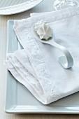 Linen napkin with hand-sewn, appliqué lace trim