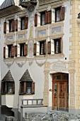 Decorated facade of three-storey building in Val Sinestra in Graubuenden canton, Switzerland