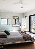 Bedroom with simple double bed and ensuite bathroom