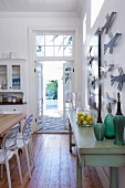 Traditional kitchen with dining area and view of terrace through open garden door