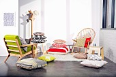 Various fashionable scatter cushions, chairs and coat stand