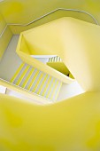 Yellow walls in freeform stairwell