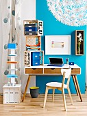Vintage desk against blue wall; stacked crates and shelving column used as mobile storage solutions