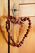 Heart-shaped wreath of horse chestnuts