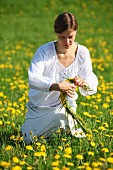 Woman making dandelion wreath