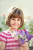 Little girl holding posy in hands