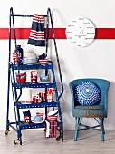 Blue, white and red - kitchen crockery on vintage stepladder with castors