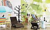 Various modern deckchairs, garden tables, garden bench and parasols