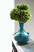 Hydrangea flowers in blue ceramic vase