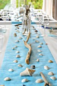 Maritime table decoration of shells and twigs