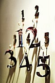 Door keys with metal numbers hanging on wall
