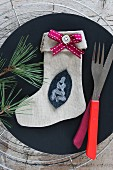 Christmas stocking (craft project) on plate with cutlery